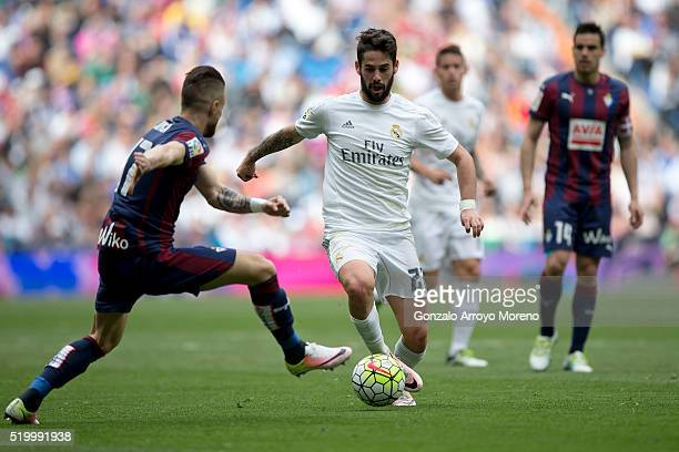 Francisco Roman Alarcon alias Isco of Real Madrid CF competes for the ball with David Junca of SD Eibar during the La Liga match between Real Madrid...