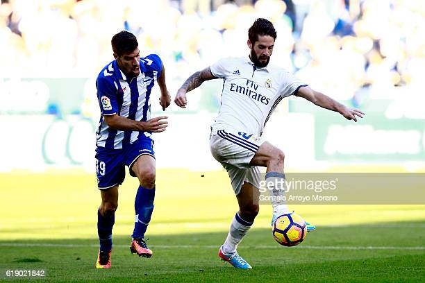 Francisco Roman Alarcon alias Isco of Real Madrid CF competes for the ball with Manuel Garcia Sanchez of Deportivo Alaves during the La Liga match...