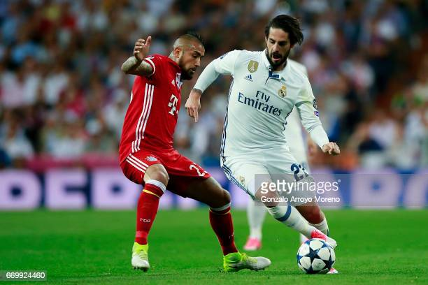 Francisco Roman Alarcon alias Isco of Real Madrid CF competes for the ball with Arturo Vidal of Bayern Muenchen during the UEFA Champions League...
