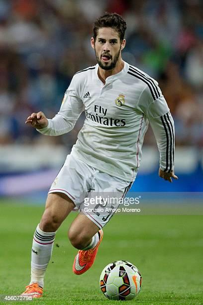 Francisco Roman Alarcon alias Isco of Real Madrid CF controls the ball during the La Liga match between Real Madrid CF and Elche CF at Estadio...