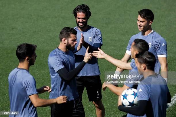 Francisco Roman Alarcon alias Isco of Real Madrid CF jokes with his teammates Nacho Fernandez Lucas Vazquez and Alvaro Morata during a training...