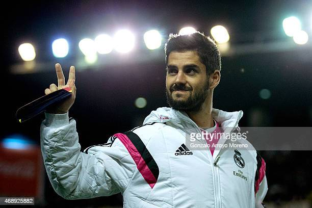 Francisco Roman Alarcon alias Isco of Real Madrid CF waves as he walks to the bench prior to the La Liga match between Rayo Vallecano de Madrid and...