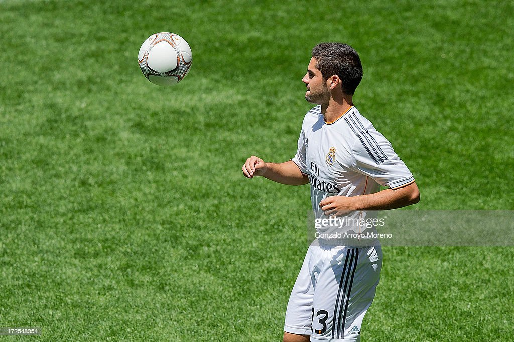 Francisco Roman Alarcon alias <a gi-track='captionPersonalityLinkClicked' href=/galleries/search?phrase=Isco&family=editorial&specificpeople=5848609 ng-click='$event.stopPropagation()'>Isco</a> plays with the ball during his presentation as a new Real madrid player at Estadio Bernabeu on July 3, 2013 in Madrid, Spain.