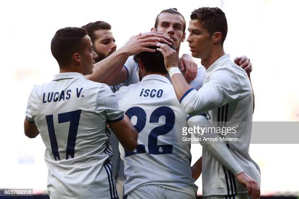 Francisco Roman Alarcon 'isco' of Real Madrid CF celebrates scoring their second goal with teammate Cristiano Ronaldo Gareth Bale Nacho Fernandez and...