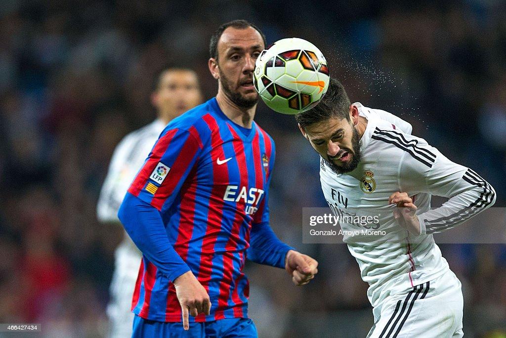 Francisco Roman Alarcon of Real Madrid CF alias Isco wins the header after Ivan Ramis of Levante UD during tha La Liga match between Real Madrid CF...