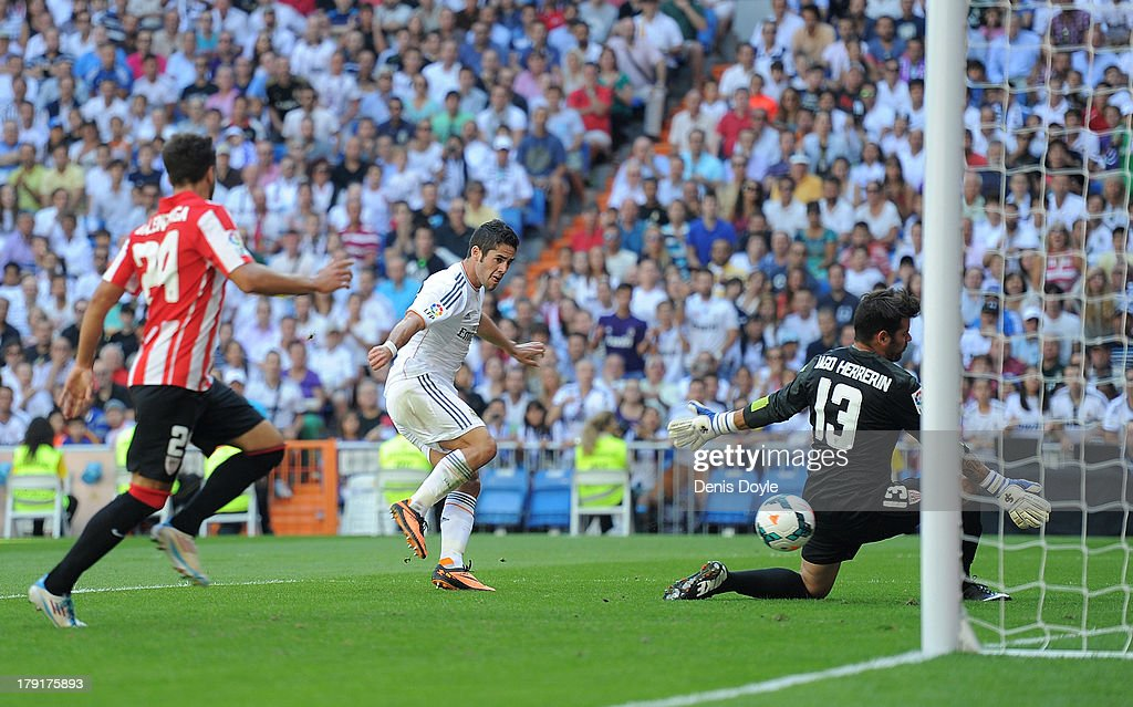 Francisco Roman 'Isco' (L) of Real Madrid shoots past Iago Herrerin of Athletic Club Bilbao to score Real's opening goal during the La Liga match between Real Madrid CF and Athletic Club Bilbao at estadio Santiago Bernabeu on September 1, 2013 in Madrid, Spain.