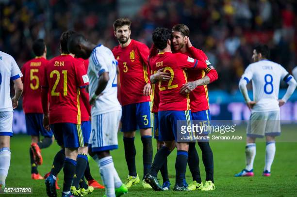 Francisco Roman 'Isco' of Spain celebrates with his teammates Sergio Ramos of Spain after scoring his team's fourth goal during the FIFA 2018 World...