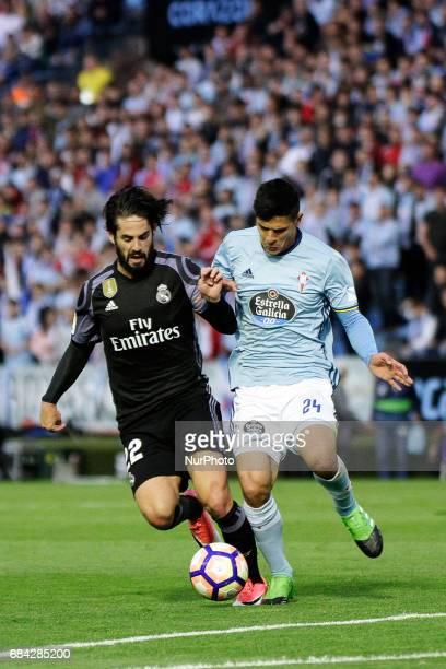 Francisco Roman quotIscoquot midfielder of Real Madrid battles for the ball with Facundo Roncaglia defender of Celta de Vigo during the La Liga...