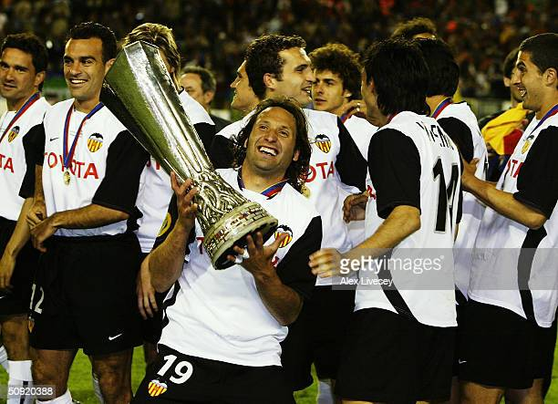 Francisco Rufete of Valencia celebrates with the trophy after the UEFA Cup Final match between Valencia and Olympique de Marseille at the Ullevi...