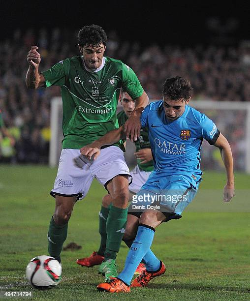 Francisco Sanchez Curiel ''Curro'' of CF Villanovense battles for the ball against Munir el Haddadi of FC Barcelona clears the ball from Casi Ruiz of...