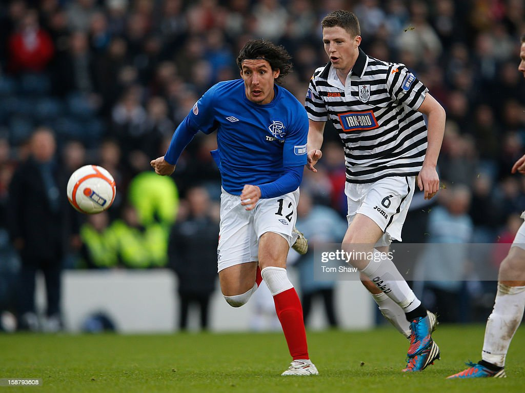 Francisco Sandaza of Rangers tussles with Paul Gallacher of Queens Park during the IRN-BRU Scottish Third Division match between Queens Park and Rangers at Hampden Park on December 29, 2012 in Glasgow, Scotland.