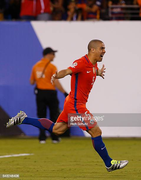 Francisco Silva of Chile celebrates after scoring the winning penalty during the championship match between Argentina and Chile at MetLife Stadium as...