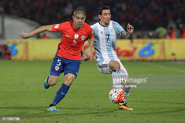 Francisco Silva of Chile fights for the ball with Angel Di Maria of Argentina during a match between Chile and Argentina as part of FIFA 2018 World...