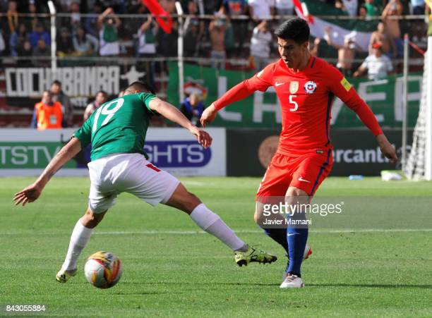 Francisco Silva of Chile fights for the ball with Jorge Flores of Bolivia during a match between Bolivia and Chile as part of FIFA 2018 World Cup...