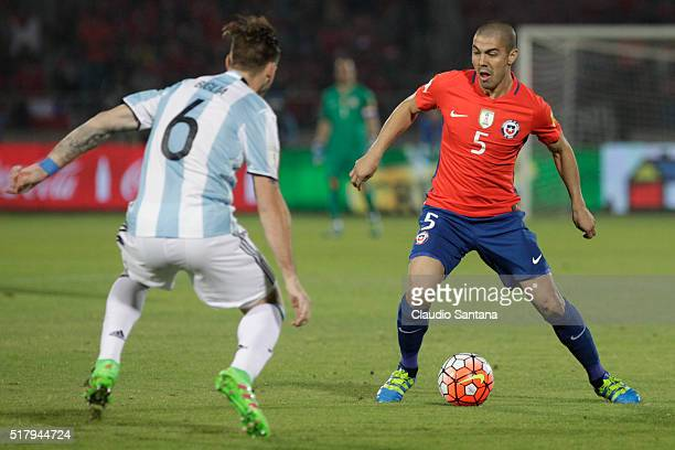 Francisco Silva of Chile fights for the ball with Lucas Biglia of Argentina during a match between Chile and Argentina as part of FIFA 2018 World Cup...