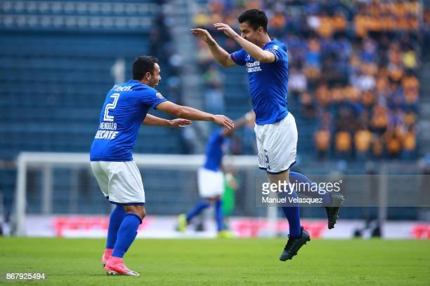 Francisco Silva of Cruz Azul celebrates his team's first goal with teammate Omar Mendoza during the 15th round match between Cruz Azul and Tigres...