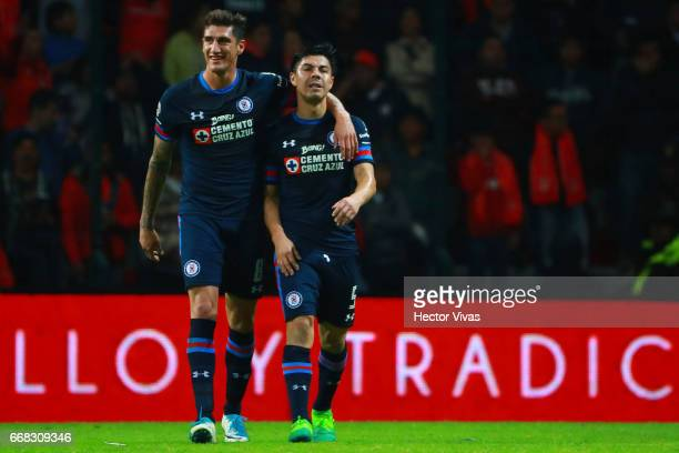 Francisco Silva of Cruz Azul celebrates with teammate Gabriel Penalba after scoring the second goal of his team during the 10th round match between...