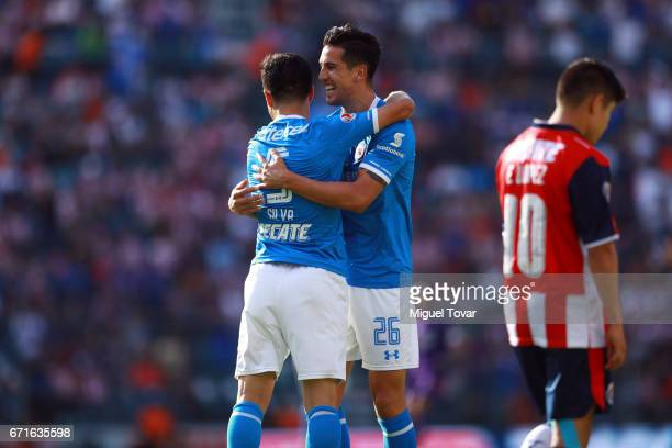 Francisco Silva of Cruz Azul celebrates with teammate Gabriel Penalba after scoring his team's first goal during the 15th round match between Cruz...