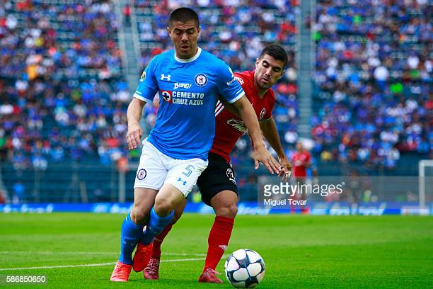 Francisco Silva of Cruz Azul fights for the ball with Damian Perez of Tijuana during the 4th round match between Cruz Azul and Tijuana as part of the...