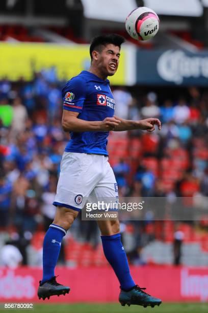 Francisco Silva of Cruz Azul heads the ball during the 12th round match between Pumas UNAM and Cruz Azul as part of the Torneo Apertura 2017 Liga MX...