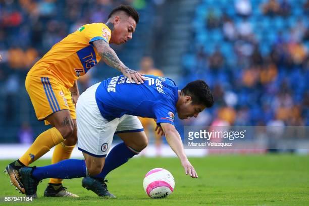 Francisco Silva of Cruz Azul struggles for the ball against Eduardo Vargas of Tigres during the 15th round match between Cruz Azul and Tigres UANL as...