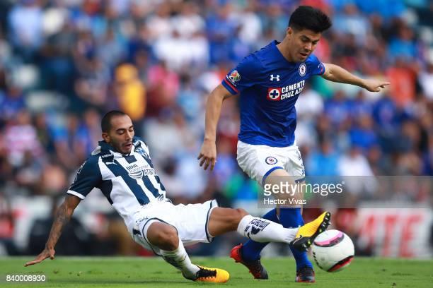 Francisco Silva of Cruz Azul struggles for the ball with Edgar Castillo of Monterrey during the seventh round match between Cruz Azul and Monterrey...