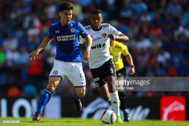 Francisco Silva of Cruz Azul struggles for the ball with Fidel Martinez of Atlas during the fifth round match between Cruz Azul and Atlas as part of...