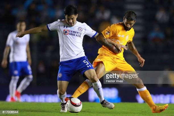 Francisco Silva of Cruz Azul struggles for the ball with Sergio Oliveira of Porto during a match between Cruz Azul and Porto as part of Super Copa...