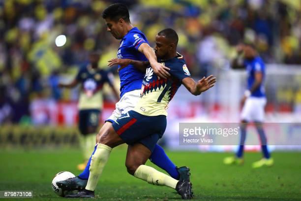 Francisco Silva of Cruz Azul struggles for the ball with William Da Silva of America during the quarter finals second leg match between America and...