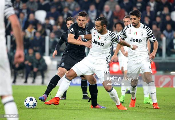 Francisco Soares of FC Porto and Medhi Benatia of Juventus in action during the UEFA Champions League Round of 16 second leg match between Juventus...