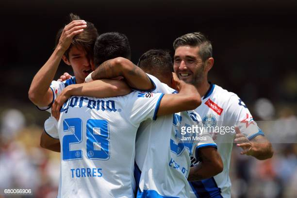 Francisco Torres of Puebla celebrates with teammates Gabriel Esparza and Carlos Orrantia after scoring the first goal of his team during the 17th...