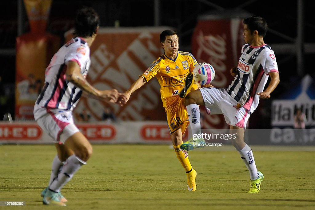 Francisco Torres of Tigres and Severo Meza of Monterrey fight for the ball during a match between Monterrey and Tigres UANL as part of 14th round...