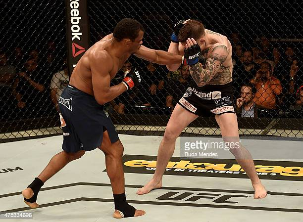 Francisco Trinaldo Massaranduba of Brazil punches Norman Park of Northern Ireland in their lightweight UFC bout during the UFC Fight Night event at...