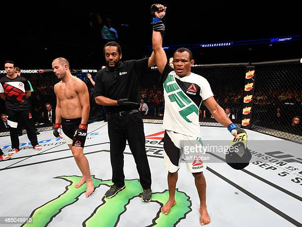 Francisco Trinaldo of Brazil celebrates after his TKO victory over Chad Laprise in their lightweight bout during the UFC event at the SaskTel Centre...