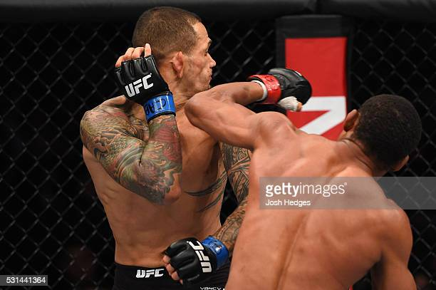 Francisco Trinaldo of Brazil punches Yancy Medeiros in their lightweight bout during the UFC 198 event at Arena da Baixada stadium on May 14 2016 in...