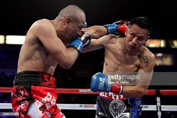 Francisco Vargas dodges a right to the head by Orlando Salido during their WBC super featherweight championship bout at StubHub Center on June 4 2016...