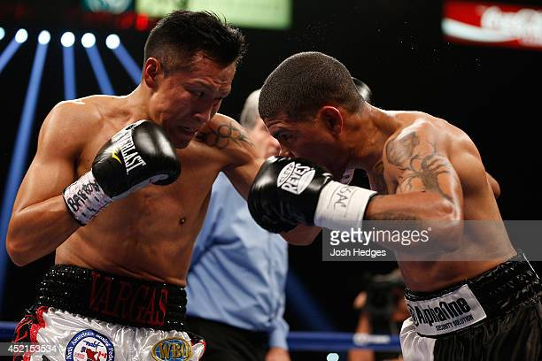 Francisco Vargas lands a left to the head of Juan Manuel Lopez during their super featherweight bout at the MGM Grand Garden Arena on July 12 2014 in...