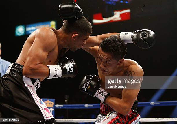 Francisco Vargas lands a right to the head of Juan Manuel Lopez during their super featherweight bout at the MGM Grand Garden Arena on July 12 2014...