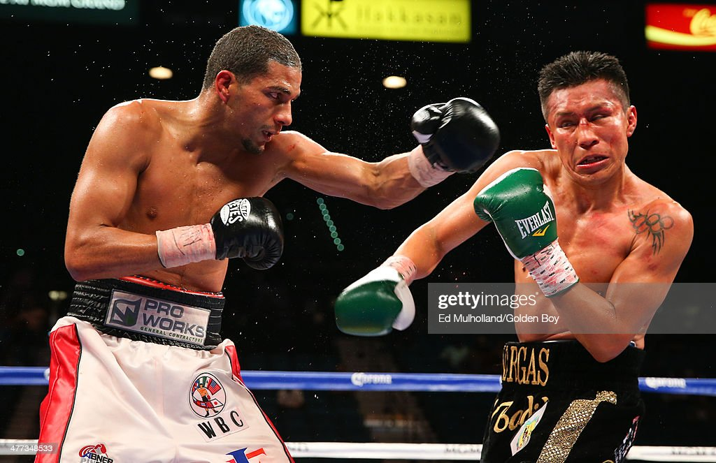 Francisco Vargas takes a left hand to the head from Abner Cotto during their 10 round junior lightweight fight at the MGM Grand Garden Arena on March...