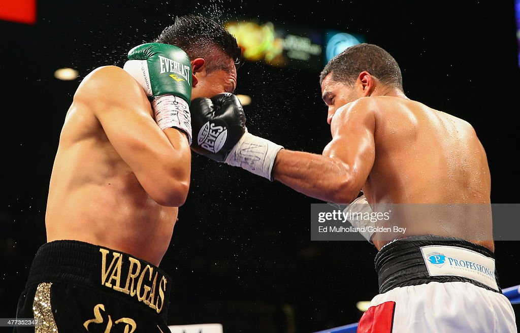 Francisco Vargas takes a left hook from Abner Cotto during their 10 round junior lightweight fight at the MGM Grand Garden Arena on March 8 2014 in...