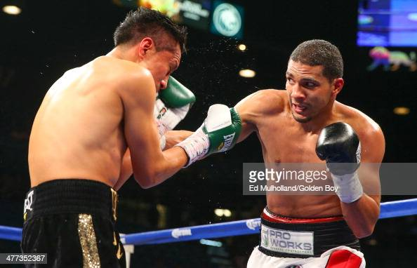 Francisco Vargas takes a right hand to the head from Abner Cotto during their 10 round junior lightweight fight at the MGM Grand Garden Arena on...