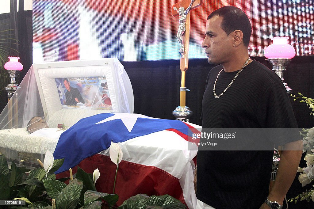 Francisco weeps for his brother Hector 'Macho' Camacho in a public memorial service at Department of Sports and Recreation on November 28, 2012 in San Juan, Puerto Rico. Camacho died after being removed from life support following a November 20, 2012 shooting in Bayamon, Puerto Rico.