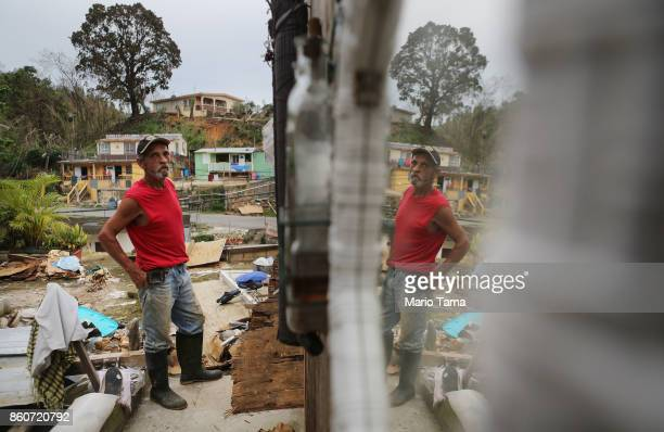Francisco Zamoro poses in his former living room reflected in a mirror still hanging on the wall three weeks after Hurricane Maria hit the island on...