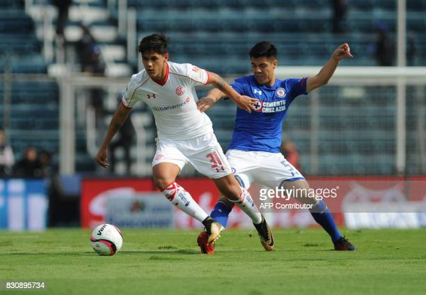 Franciso Silva of Cruz Azul vies for the ball with Martin Abundiz of Toluca during their Mexican Torneo Apertura 2017 football match at Azul Stadium...