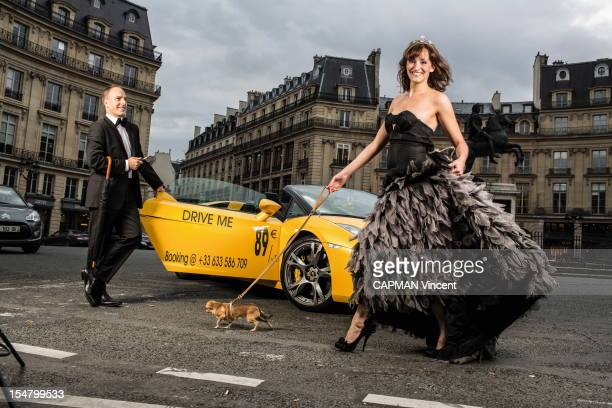 Franck and his wife Caroline pose with a Lamborghini Gallardo rental through affordable luxury by renting in Paris Place des Victoires on October...