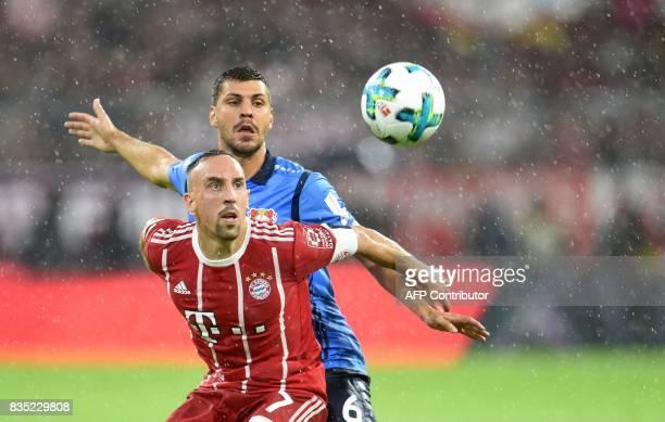 Franck Bayern Munich's French midfielder Franck Ribery and Leverkusen's Austrian defender Aleksandar Dragovic vie for the ball during the German...