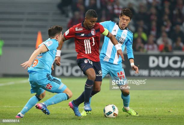 Franck Beria of Lille and Hiroki Sakai of OM in action during the Ligue 1 match between Lille OSC and Olympique de Marseille at Stade PierreMauroy on...