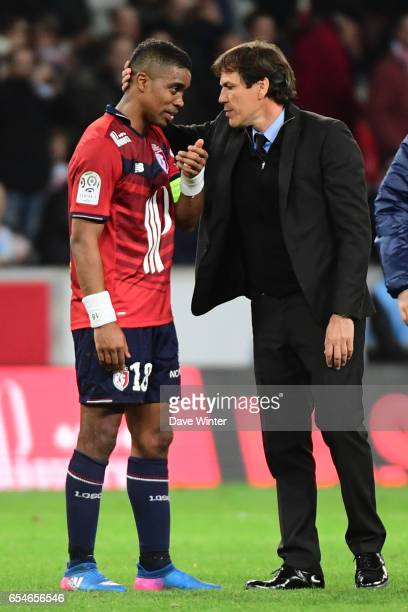 Franck Beria of Lille is greeted by Marseille coach Rudi Garcia who used to be coach of Lille following the Ligue 1 match between Lille OSC and...