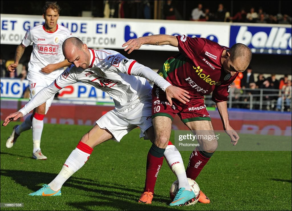 Franck Berrier (SV Zulte Waregem) and Laurent Ciman of Standard Liege during the Jupiler League match between Zulte - Waregem and Standard of Liege on November 18, 2012 in Waregem , Belgium.
