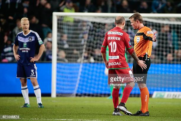 Franck Berrier midfielder of KV Oostende with referee Serge Gumienny pictured during the Jupiler Pro League match between RSC Anderlecht and KV...